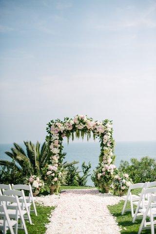 wisteria-lane-flowers-full-rose-petal-aisle-floral-arch-outdoor-wedding-bel-air-bay-club