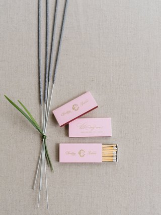 wedding-reception-sparkler-exit-sparkler-tied-with-greenery-pink-matchbox-with-matches-gold-monogram