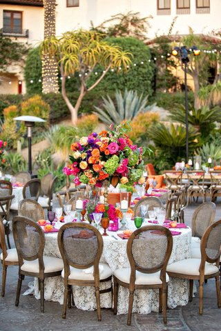 outdoor-wedding-reception-bohemian-chic-rikki-ladenheim-events-wood-chair-pink-orange-yellow-purple
