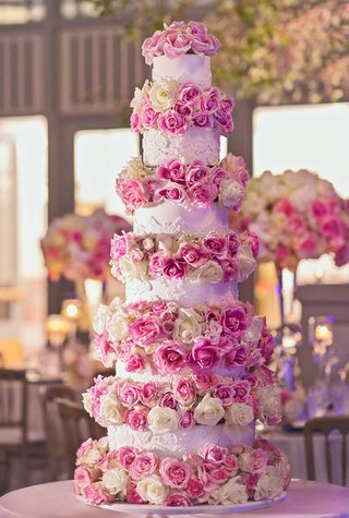 tall-white-wedding-cake-with-six-layers-fresh-pink-rose-white-rose-flowers-in-between-each-tier