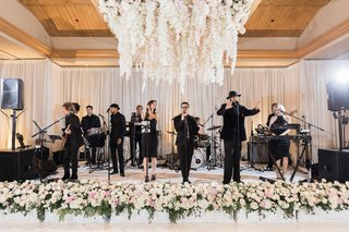 wedding-reception-live-music-band-at-wedding-reception-flower-chandelier-flowers-in-front-of-stage