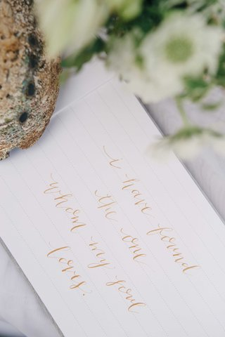 a-guest-book-quote-written-in-rose-gold-calligraphy