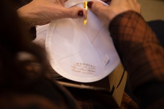 mother-of-the-groom-prepares-clip-on-yarmulke