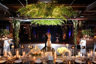 bride and groom on dance floor ceiling installation greenery twinkle lights the gold coast all stars