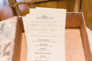 wedding-ceremony-program-in-box-with-gold-lettering-and-details-of-proceedings