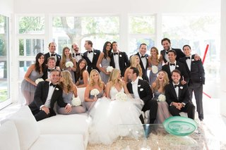 bride-in-vera-wang-halter-gown-and-groom-with-bridesmaids-groomsmen-in-brides-family-home