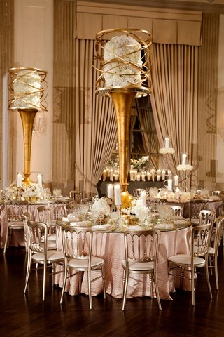 wedding-reception-round-table-metallic-chair-mirror-top-gold-centerpiece-hydrangeas-swirling-metal