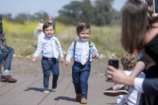 wedding-ceremony-outdoor-ring-bearers-in-navy-blue-slacks-pants-light-blue-shirts-pink-tie-suspender