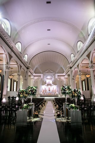 vibiana-wedding-ceremony-with-white-aisle-runner-greenery-and-burgundy-flower-arrangements-altar