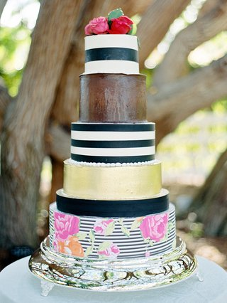 whimsical-wedding-cake-with-black-and-white-stripes-gold-and-flower-print-decorations