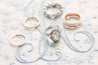 oval-cut-diamond-engagement-ring-in-platinum-and-rose-gold-with-pave-diamonds-on-band-and-halo