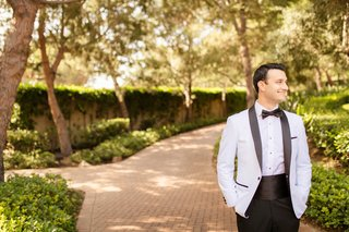 groom-in-formal-tuxedo-with-cummerbund-and-white-jacket