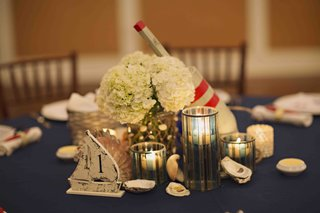 wood-buoy-and-sailboat-centerpiece-at-rehearsal-dinner