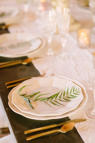 white-charger-plates-sprig-greenery-wood-table-faux-wedding-party-styled-shoot-rustic-event-gold