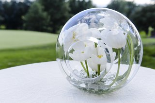 white-tulips-inside-glass-globe-orb-decoration-at-wedding