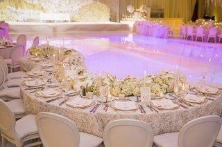 winding-table-around-reflective-dance-floor-indian-hindu-wedding-purple-lighting-florals