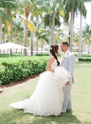 bride-in-vera-wang-halter-gown-with-long-side-braid-and-groom-in-light-suit-and-slip-on-shoes