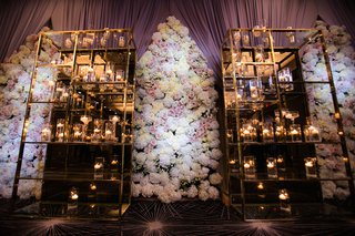 wedding-reception-with-a-modern-mirrored-metal-stands-candles-floral-panels-of-white-hydrangeas