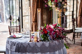 vintage-inspired-purple-sweetheart-table-with-taper-candles-and-organic-flower-arrangements