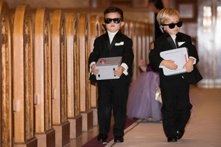 two-ring-bearers-in-sunglasses-holding-safes-filled-with-the-wedding-rings