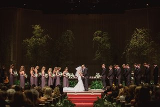 trees-brought-into-church-ceremony-wedding-dark-with-red-carpet