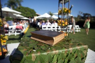 holy-bible-on-table-at-altar-with-green-leaf-decorations