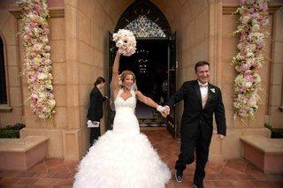 bride-and-groom-leaving-hotel-chapel