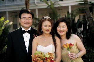 parents-and-bride-holding-orange-bouquet