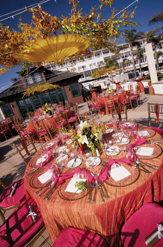 orange-tablecloth-with-pink-chairs-and-napkins