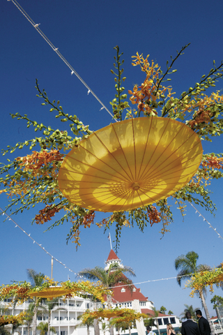 upside-down-parasols-decorated-with-orchid-blossoms-hang-above-tables