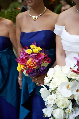 bridesmaid-holding-vibrantly-colored-flowers