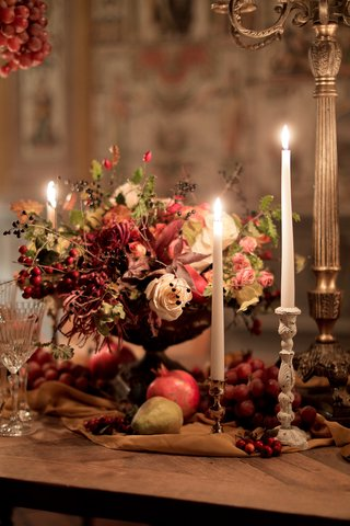 renaissance-inspired-tablescape-in-palace-in-florence-fall-colors-berries-pears-pomegranates