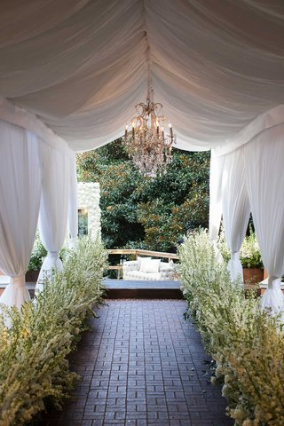 entrance-to-outdoor-lounge-area-white-stock-drapery-chandeliers-outdoor-cocktail-hour