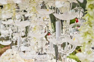 wedding-centerpieces-with-an-orchid-blossom-encased-in-glass-orbs