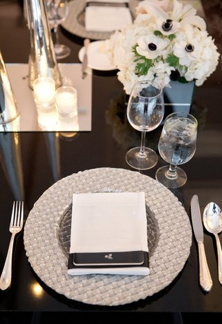 white-napkin-on-top-of-woven-silver-charger-plate-wedding-reception