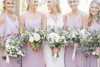 textured-bridal-and-bridesmaid-bouquets-with-olive-eucalyptus-anemones-white-blossoms