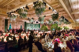 wedding-reception-ballroom-greenery-ceiling-floral-chandelier-low-centerpiece-tall-tree-centerpieces