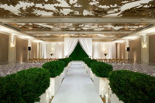 wedding-ceremony-ballroom-gold-ceiling-hedge-along-aisle-hedge-wall-backdrop-white-drapery