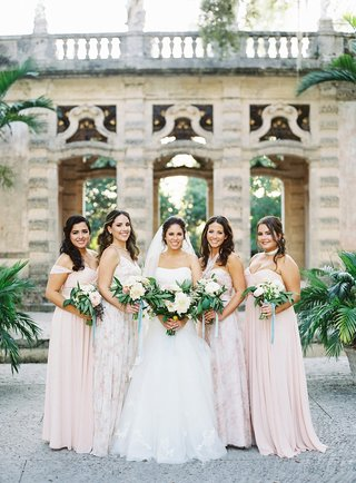 bride-in-wedding-dress-with-pink-bridesmaid-dresses-green-bouquets-natural-ribbon-four-bridesmaids