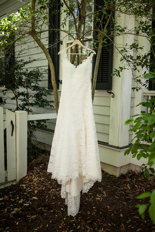 bridal-gown-hanging-on-hanger-outside-in-south-carolina-lace-cap-sleeve-low-back-romona-keveza
