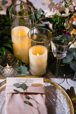 wedding-reception-flameless-candle-gold-rim-glassware-charger-plate-pink-napkin-greenery-eucalyptus