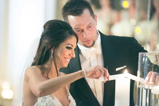 wedding-ceremony-chris-johnson-and-tia-garavuso-lighting-unity-candle-at-biltmore-ballrooms-ceremony