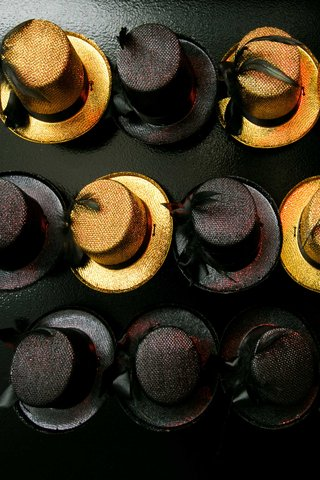 black-and-gold-top-hats-as-favors-for-guests-for-this-new-years-eve-wedding