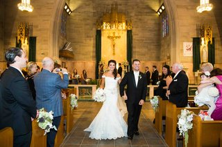 bride-and-groom-exit-ceremony-at-roman-catholic-church