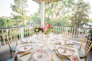 textured-white-linen-flower-print-napkins-pink-hot-pink-flower-centerpiece-gold-flatware-gold-chairs