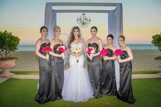 bride-in-mermaid-wedding-dress-with-bridesmaids-sweetheart-necklines-ocean-ceremony-view-chandelier