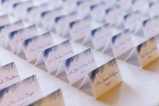 white-escort-cards-with-blue-calligraphy-and-blue-watercolor-accents