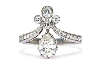 tiara-ii-ring-in-platinum-featuring-a-0-71ct-pear-shape-diamond-with-bezel-set-and-single-cut-diam