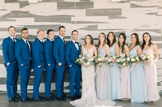 bridesmaids-in-pale-blue-and-blush-hues-groomsmen-in-blue-suits