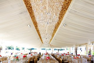 wedding-tent-with-a-ruffled-center-of-white-and-gold-crystal-chandeliers-and-glass-globes